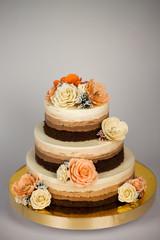 Obraz na płótnie Canvas Naked cake. Wedding rustic cake with flowers.