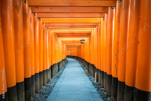Path of oranges japanese gates in a temple in Kyoto