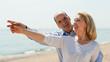 Elderly senior with mature woman at seashore vacation