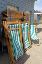 Stripey Deckchairs Piled Up At The Side Of The Beach At Bridlington, East Yorkshire, UK