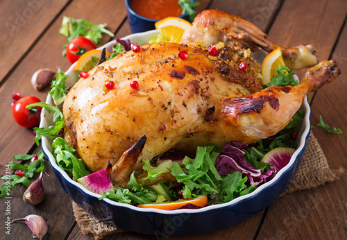 Fototapety, obrazy: Baked chicken stuffed with rice for Christmas dinner on a festive table