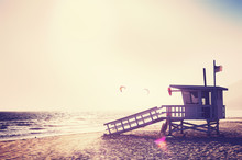Vintage Filtered Lifeguard Tower At Sunset With Lens Flare Effect, Malibu, California.