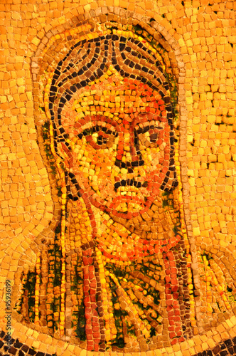 Ancient roman mosaic of woman with a stern expression © camerawithlegs