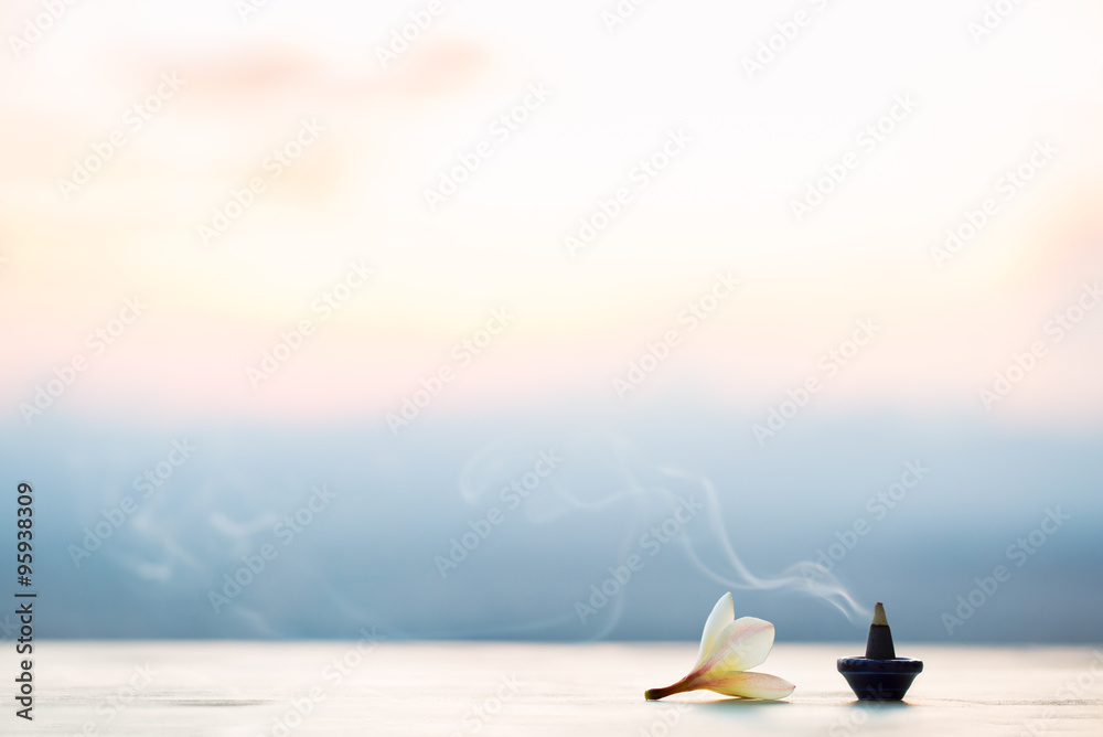 Fototapety, obrazy: Smoke incense cones with plumeria flower on sunset