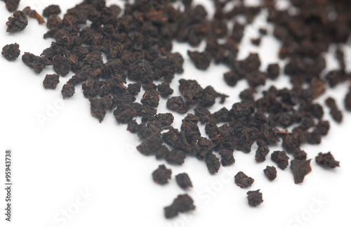 Fotografie, Obraz  dry black tea on a white background
