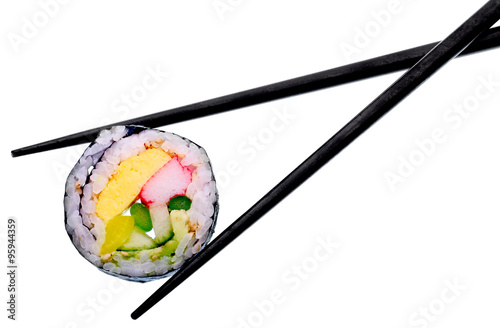 Foto  Sushi roll with black chopsticks isolated on white background