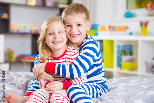 Cute little brother and sister in pajamas Poster Mural XXL