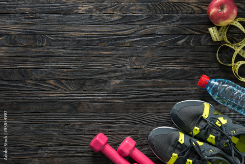 sport fitness items on dark wooden background