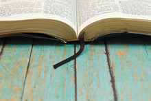 Opened Bible With A Bookmark O...