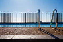 Swimming Pool Edge With Ladder And Sky Background