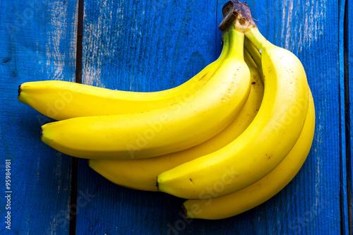 Fotografie, Tablou  Fresh bananas on wooden background