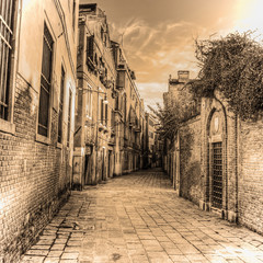 picturesque backstreet in Venice in sepia tone