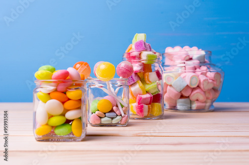 Poster Confiserie Colorful candy in jar on table selective focus