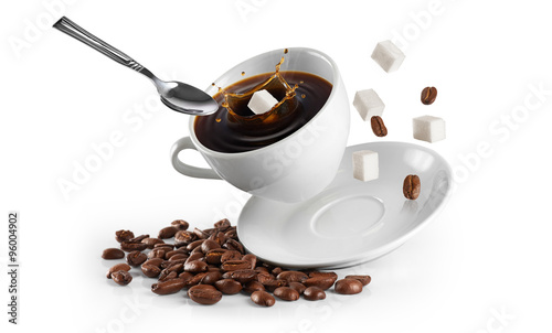 Keuken foto achterwand Cafe Cup of coffee with coffee beans and sugar on a white background.