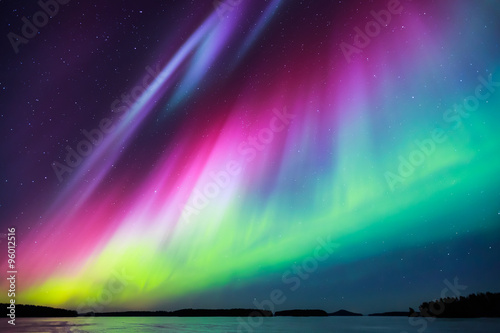 Photo sur Aluminium Aurore polaire Northern lights (Aurora borealis) in the sky