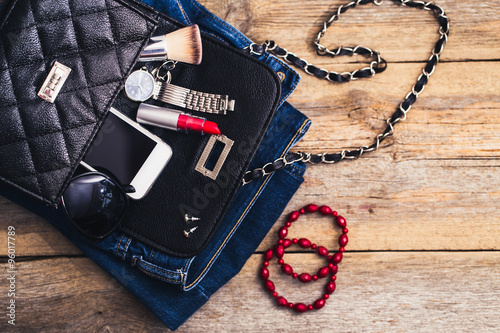Fashion accessories for a young girl, watch, bracelet, handbag,