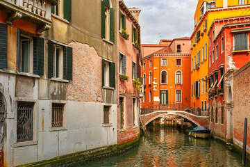 Colorful lateral canal and bridge in Venice, Italy