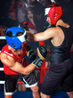 Two men boxer wearing helmet boxing .