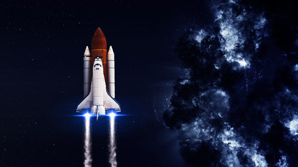 Fototapeta Space shuttle taking off on a mission. Elements of this image furnished by NASA