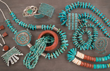 """Collection Of Vintage Native American Jewelry . A Santo Domingo """"Depression Era"""" Necklace, And Turquoise """"Nugget"""" Necklaces With Silver Beads, And Zuni And Navajo Bracelets, Grey Slate Background."""