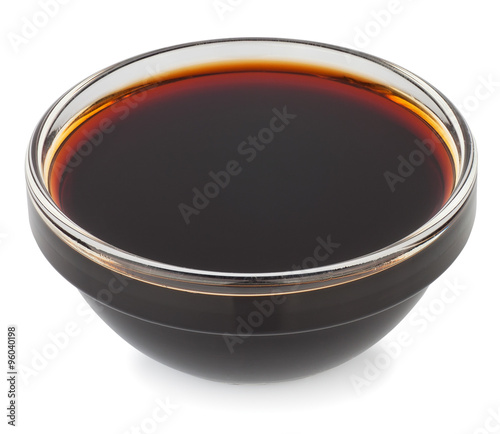 Soy sauce in small glass bowl isolate