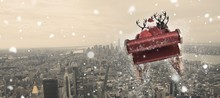 Composite Image Of Santa Flyin...