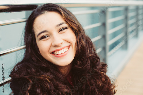 Cute brunette woman laughing in the street