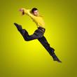 flamenco dancer man jumping on yellow in full length.