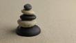Stones pyramid on sand symbolizing zen.