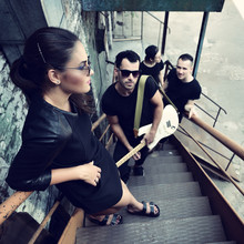 Music Band Outdoor Portrait. Musicians And Woman Soloist Posing