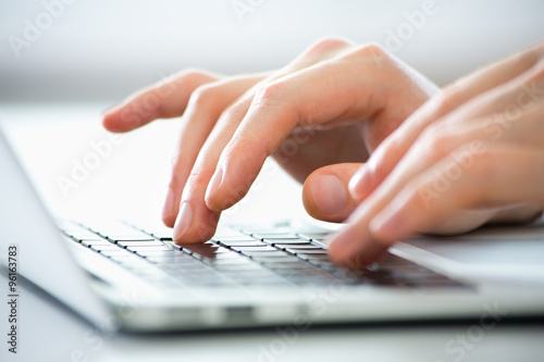 Canvas Print Close-up of hands of business man typing on a laptop.