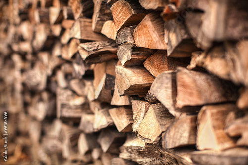 Poster Firewood texture background of Heap firewood stack, natural wood
