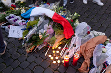 Flowers And Lit Candles In Front Of The French Embassy In Piazza