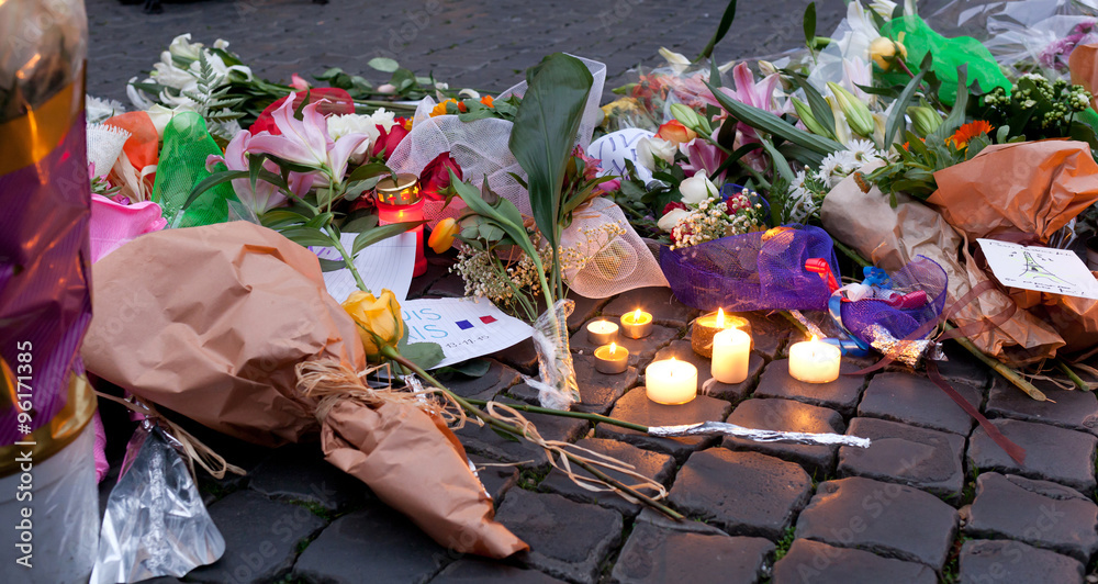 Fototapeta Flowers and lit candles in front of the French Embassy in Piazza