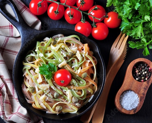 fototapeta na lodówkę Vegetarian pasta with spinach, carrots, beets, Parmesan cheese, capers, olive oil, cherry tomatoes and parsley.
