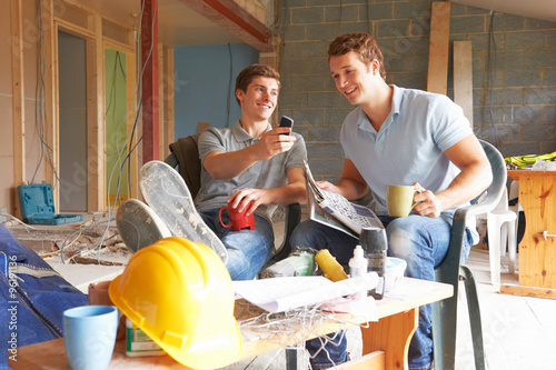 Fotografie, Obraz  Builders Relaxing During Break On Site