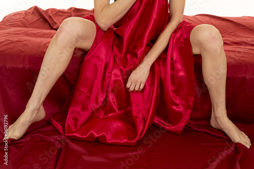 woman legs sitting in red sheet Poster