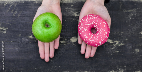Photo  Choosing between apple and doughnut