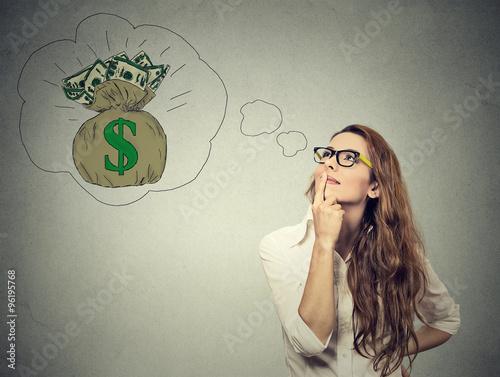 Woman dreaming of financial success - fototapety na wymiar