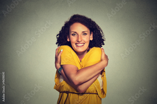 Fotomural happy smiling woman holding hugging herself