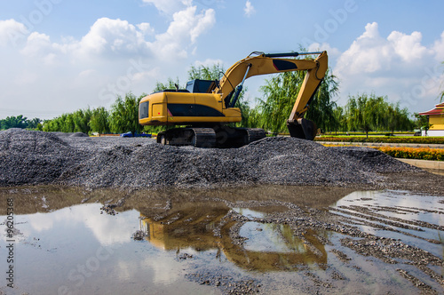 Fotografia, Obraz  Backhoe standing on stone on construction site.
