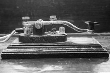 Old Morse Key Telegraph On Wood Table