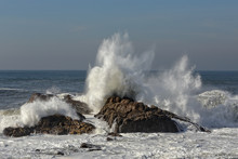 Splashing Waves Against Rocks