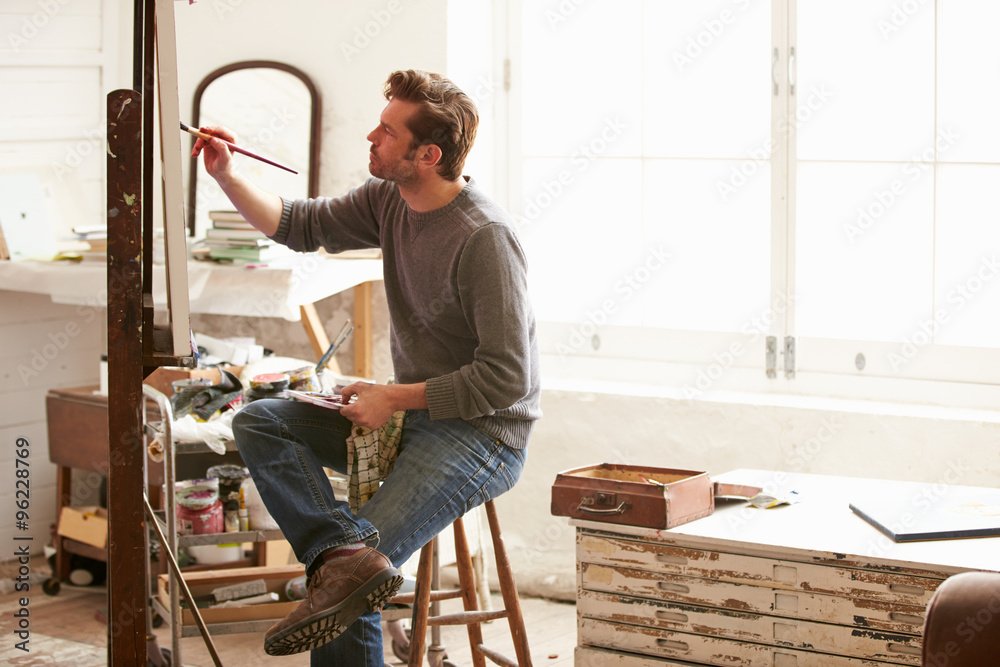 Fototapety, obrazy: Male Artist Working On Painting In Studio