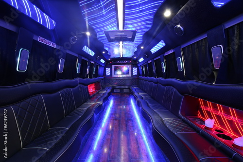 a big party bus fill ed with comfortable seats and shiny bright floor for dancin Wallpaper Mural