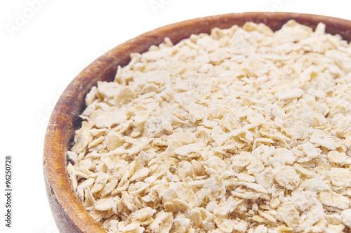 Fototapeta Oatmeal.  Bowl full of oats  obraz na płótnie