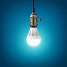 Glowinng LED Bulb On Blue Background
