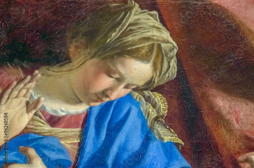 A detail of an old cracked painting of the Virgin Mary in the moment of Anunncia Canvas Print