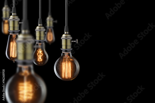 Photo  vintage glowing light bulbs on black background