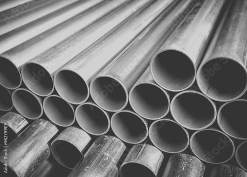 Fotografia  Close - up Stack of construction metal pipes